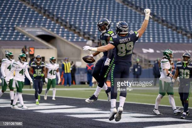 David Moore of the Seattle Seahawks celebrates with Will Dissly after scoring a 3 yard touchdown against the New York Jets during the third quarter...