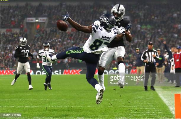 David Moore of the Seattle Seahawks is challanged for the ball by Daryl Worley of the Oakland Raiders during the NFL International Series game...