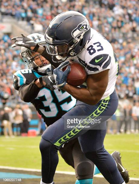 David Moore of the Seattle Seahawks makes the game-tying touchdown catch against Corn Elder of the Carolina Panthers during the fourth quarter of...