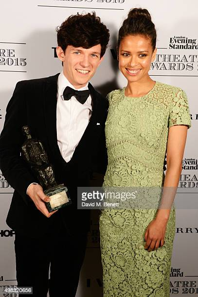 David Moorst winner of the Emerging Talent Award in partnership with Burberry poses with presenter Gugu MbathaRaw in front of the Winners Boards at...