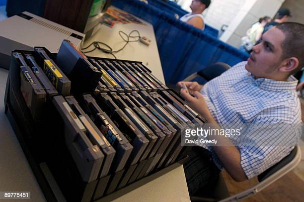 David Moreno of San Diego, California plays on an orignial Nintendo Entertainment System at the launch party for the International Video Game Hall of...