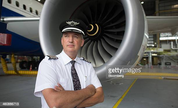 David Morgan chief pilot at Air New Zealand Ltd stands for a photograph in front of a Boeing Co 7879 Dreamliner test aircraft in a hangar at Air New...