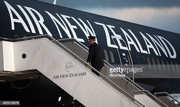 David Morgan chief pilot at Air New Zealand Ltd walks onboard a Boeing Co 7879 Dreamliner aircraft operated by Air New Zealand at Auckland...