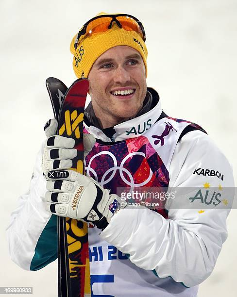 David Morris of Australia celebrates his silver medal in men's aerials at Rosa Khutor Extreme Park during the Winter Olympics in Sochi Russia Monday...