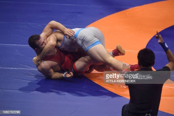David Morris Taylor III and Turkey's Fatih Erdin compete during the final of the men's freestyle wrestling 86g category at the World Wrestling...