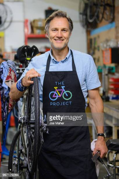 David Morrissey attends a photocall to announce the National Lottery funding of The Bike Project at The Bike Project on July 12 2018 in London...