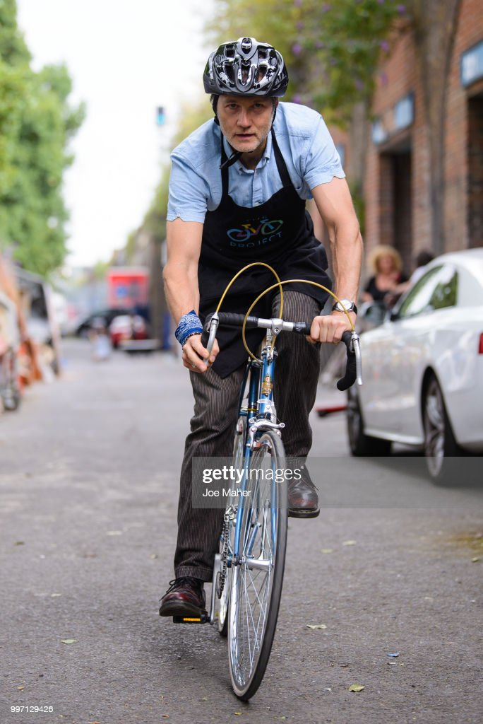 David Morrissey attends a photocall to announce the National Lottery funding of The Bike Project at The Bike Project on July 12, 2018 in London, England. The Bike Project recycles second hand bicycles and donates them to asylum seekers and refugees.