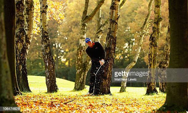 David Mortimer of Fore Ireland plays from behind the trees on the 6th hole during the first day of the Srixon PGA Playoff Final at Little Aston Golf...