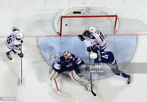 David Moss of USA fails to score over Cristobal Huet , goaltender of France during the IIHF World Championship group H match between USA and France...
