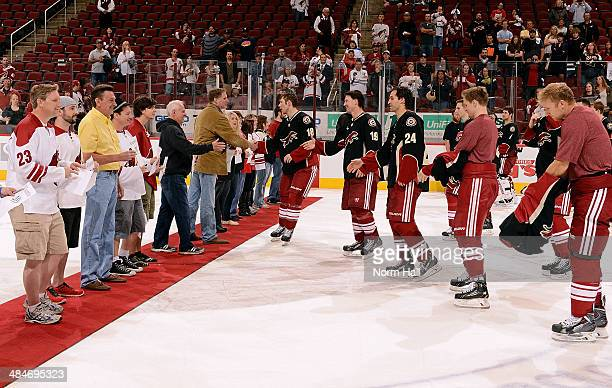 David Moss, Shane Doan, Kyle Chipchura, Lauri Korpikoski and Rob Klinkhammer of the Phoenix Coyotes give fans the jerseys off their backs following a...