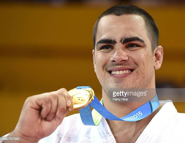 David Moura of Brazil celebrates his gold medal win over Freddy Figueroa of Ecuador in the plus 100kg judo during the 2015 Pan Am games at the...