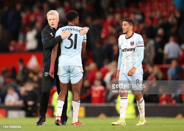 David Moyes embraces Ben Johnson of West Ham United after their sides victory in the Carabao Cup Third Round match between Manchester United and West...