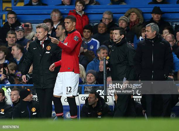 David Moyes Manager / head coach of Manchester United stands with Chris Smalling of Manchester United as Jose Mourinho the head coach / manager of...