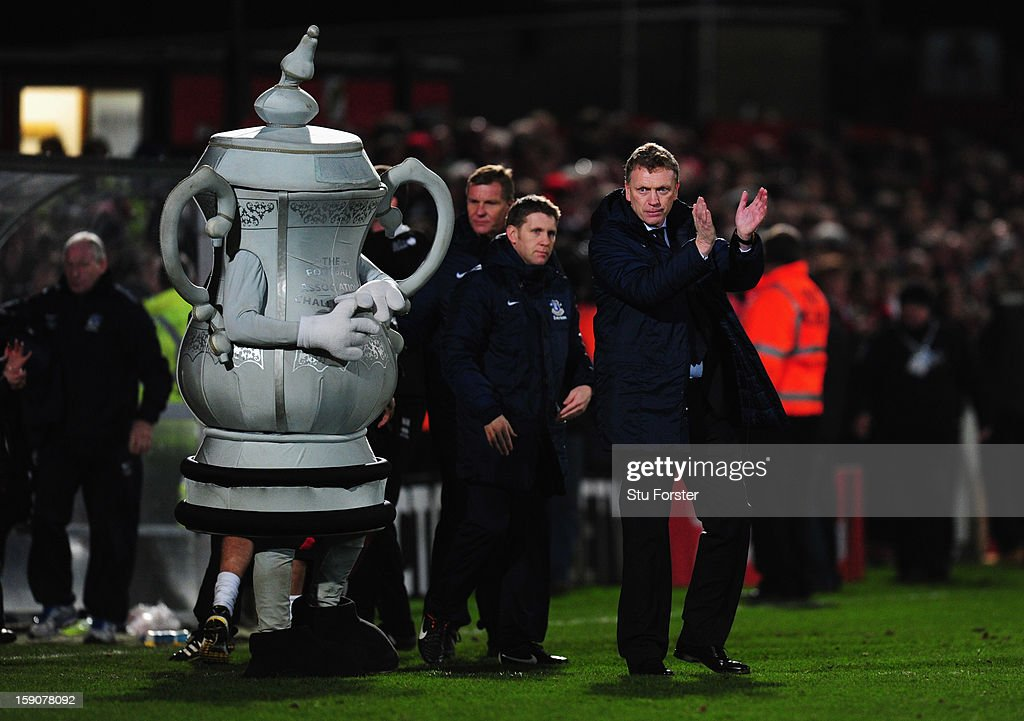 David Moyes manager of Everton applauds the travelling fans as the FA Cup mascot looks on after the FA Cup with Budweiser Third Round match between Cheltenham Town and Everton at Abbey Business Stadium on January 7, 2013 in Cheltenham, England.