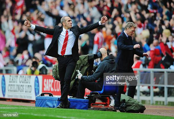 David Moyes manager of Everton reacts as Paolo Di Canio manager of Sunderland celebrates as Stephane Sessegnon scores their first goal during the...