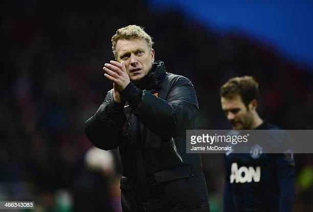 David Moyes manager of Manchester United walks off with Juan Mata after the Barclays Premier League match between Stoke City and Manchester United at...