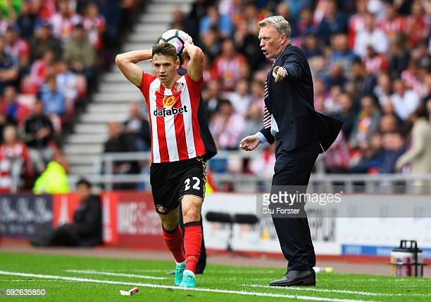 David Moyes Manager of Sunderland gives instructions as Donald Love of Sunderland takes a throw in during the Premier League match between Sunderland...
