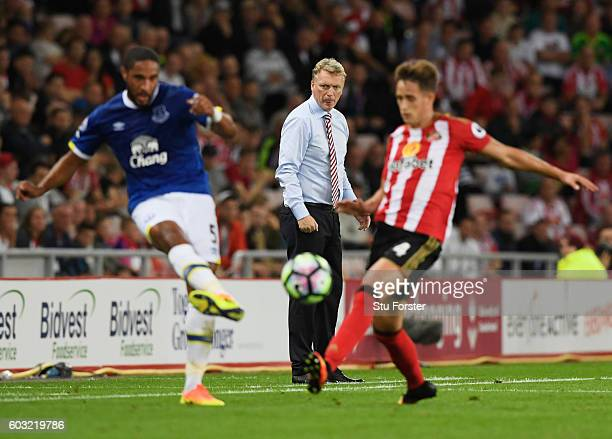 David Moyes manager of Sunderland watches Ashley Williams of Everton and Adnan Januzaj of Sunderland in action during the Premier League match...