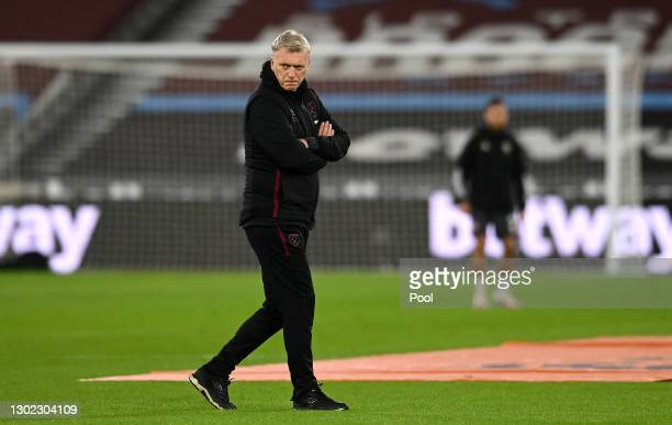 David Moyes, Manager of West Ham looks on while the teams warm up ahead of the Premier League match between West Ham United and Sheffield United at...