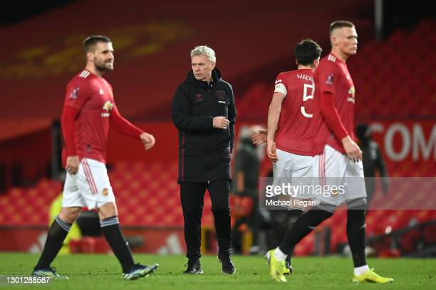 David Moyes, Manager of West Ham shakes hands with Harry Maguire of Manchester United following The Emirates FA Cup Fifth Round match between...