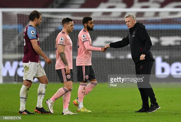 David Moyes, Manager of West Ham shakes hands with Jayden Bogle of Sheffield United following the Premier League match between West Ham United and...