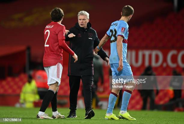 David Moyes, Manager of West Ham shakes hands with Victor Lindeloef of Manchester United following The Emirates FA Cup Fifth Round match between...