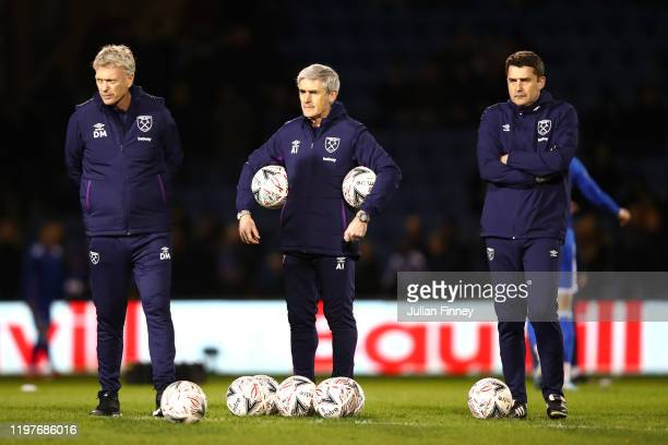 David Moyes, Manager of West Ham United and Alan Irvine, assistant manager of West Ham United look on as their team warm up prior to the FA Cup Third...
