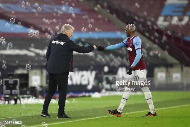David Moyes, Manager of West Ham United and Angelo Ogbonna of West Ham United interact after the Premier League match between West Ham United and...