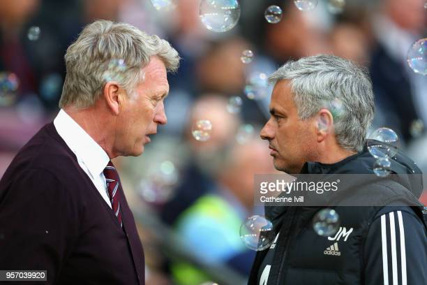 David Moyes Manager of West Ham United and Jose Mourinho Manager of Manchester United speak prior to the Premier League match between West Ham United...