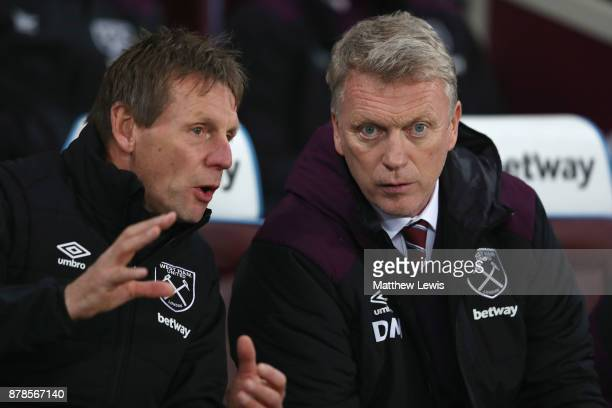 David Moyes Manager of West Ham United and Stuart Pearce assistant manager of West Ham United in discussion prior to the Premier League match between...