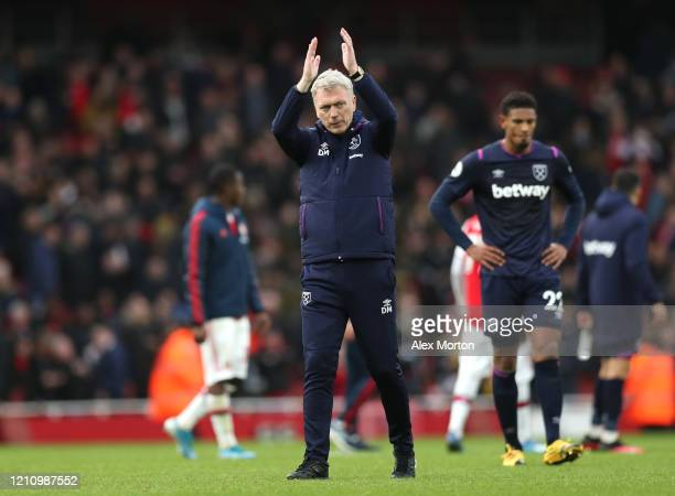 David Moyes Manager of West Ham United applaud fans following his teams defeat in the Premier League match between Arsenal FC and West Ham United at...