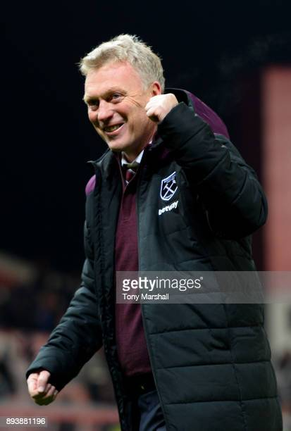 David Moyes Manager of West Ham United celebrates victory after the Premier League match between Stoke City and West Ham United at Bet365 Stadium on...