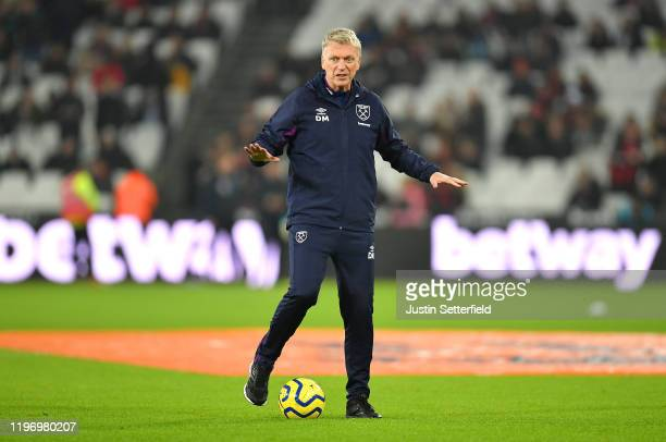 David Moyes, Manager of West Ham United gives his team instructions as they warm up prior to the Premier League match between West Ham United and AFC...