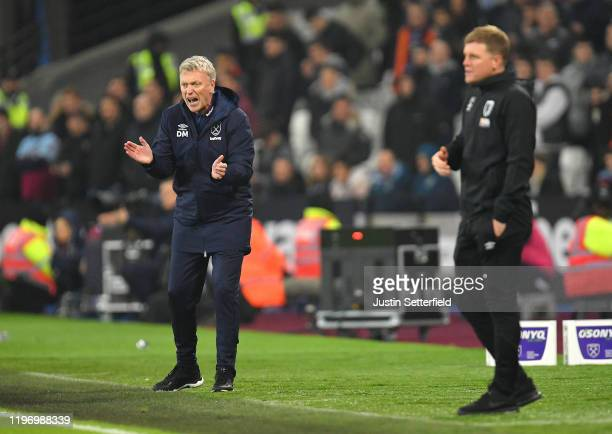 David Moyes, Manager of West Ham United gives his team instructions as Eddie Howe, Manager of AFC Bournemouth reacts during the Premier League match...