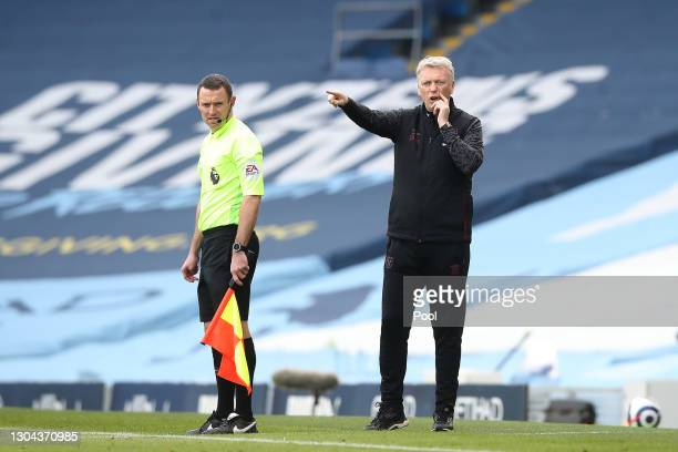 David Moyes, Manager of West Ham United gives his team instructions during the Premier League match between Manchester City and West Ham United at...
