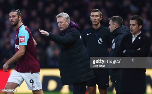 David Moyes Manager of West Ham United gives instructins to Andy Carroll of West Ham United during the Premier League match between Watford and West...