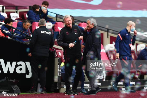 David Moyes , Manager of West Ham United interacts with Jose Mourinho, Manager of Tottenham Hotspur prior to the Premier League match between West...
