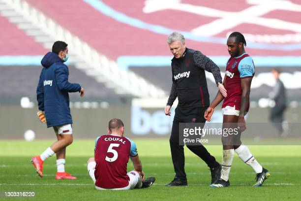 David Moyes, Manager of West Ham United interacts with Michail Antonio and Vladimir Coufal of West Ham United following the Premier League match...