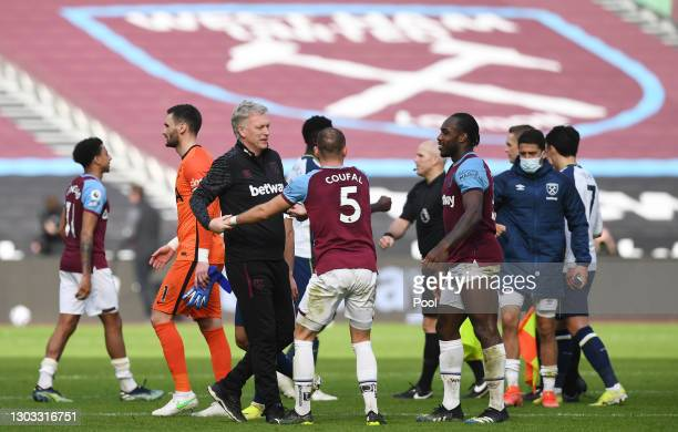 David Moyes, Manager of West Ham United interacts with Vladimir Coufal and Michail Antonio of West Ham United following the Premier League match...