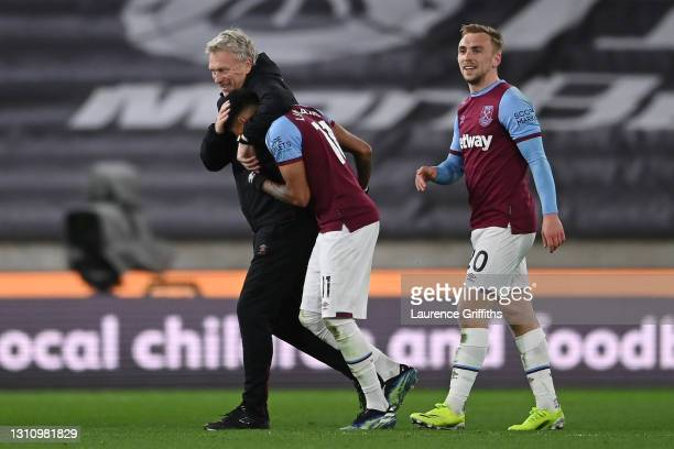 David Moyes, Manager of West Ham United, Jesse Lingard and Jarrod Bowen of West Ham United celebrate following their side's victory in the Premier...