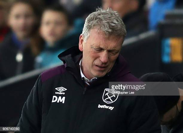 David Moyes Manager of West Ham United looks dejected during the Premier League match between Swansea City and West Ham United at Liberty Stadium on...