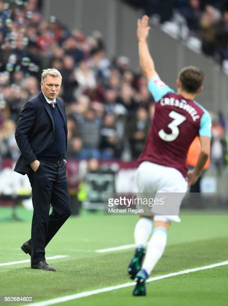 David Moyes Manager of West Ham United looks on as Aaron Cresswell of West Ham United celebrates after scoring his sides first goal during the...