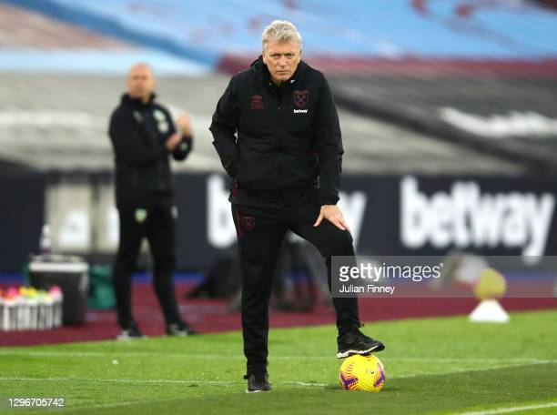 David Moyes, Manager of West Ham United looks on as he stand on the ball during the Premier League match between West Ham United and Burnley at...