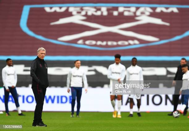 David Moyes, Manager of West Ham United looks on as players warm up prior to the Premier League match between West Ham United and Tottenham Hotspur...