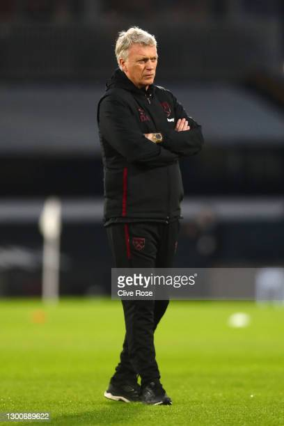 David Moyes, Manager of West Ham United looks on during the warm up prior to the Premier League match between Fulham and West Ham United at Craven...