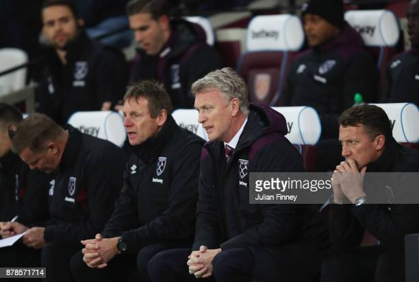 David Moyes Manager of West Ham United looks on from the bench alongside Stuart Pearce assistant manager of West Ham United and Billy McKinlay coach...