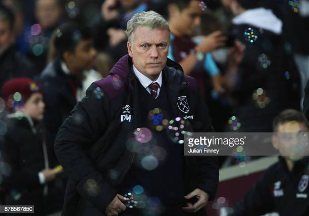 David Moyes Manager of West Ham United looks on through the bubbles prior to the Premier League match between West Ham United and Leicester City at...