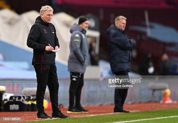 David Moyes, Manager of West Ham United makes notes during the Premier League match between Aston Villa and West Ham United at Villa Park on February...