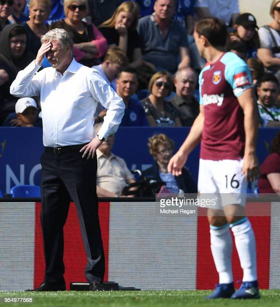 David Moyes Manager of West Ham United reacts as Mark Noble of West Ham United looks on during the Premier League match between Leicester City and...