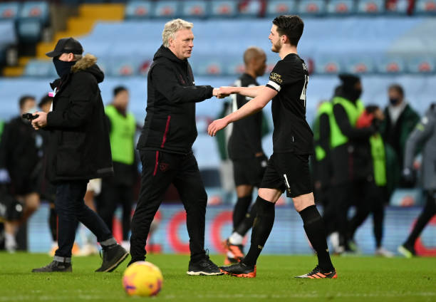 David Moyes, Manager of West Ham United reacts with Declan Rice of West Ham United following the Premier League match between Aston Villa and West...